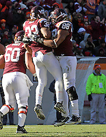 Nov 27, 2010; Charlottesville, VA, USA; Virginia Tech Hokies running back Ryan Williams (34) celebrates his touchdown with teammate Virginia Tech Hokies tight end Andre Smith (88) during the game at Lane Stadium. Virginia Tech won 37-7. Mandatory Credit: Andrew Shurtleff