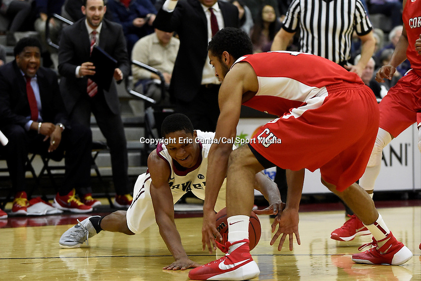 Friday, January 29, 2016: Harvard Crimson guard Agunwa Okolie (35) and Cornell Big Red forward Jordan Abdur-Ra'oof (12) scramble for a loose ball during the NCAA basketball game between the Cornell Big Red and the Harvard Crimson held at the Lavietes Pavilion in Boston, Massachusetts. Cornell defeats Harvard 65-77. Eric Canha/CSM