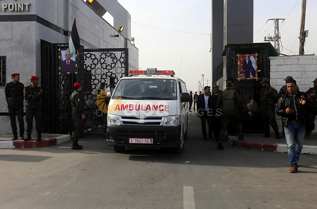 A picture taken on November 18, 2017 shows an ambulance crossing to the Palestinian side from the gates of the Rafah border crossing with Egypt in the southern Gaza strip, as the crossing opened for three days for the first time since the Palestinian reconciliation deal. Only humanitarian cases registered with the Palestinian Interior ministry would be allowed to leave through the crossing, however, with this including up to 20,000 people in the empoverished enclave of two million. That Egypt-brokered Palestinian reconciliation deal is expected to lead to more regular opening of the Rafah crossing, which had been totally sealed since August 2017, and was largely closed by Cairo for years beforehand. Photo by Yasser Qudih