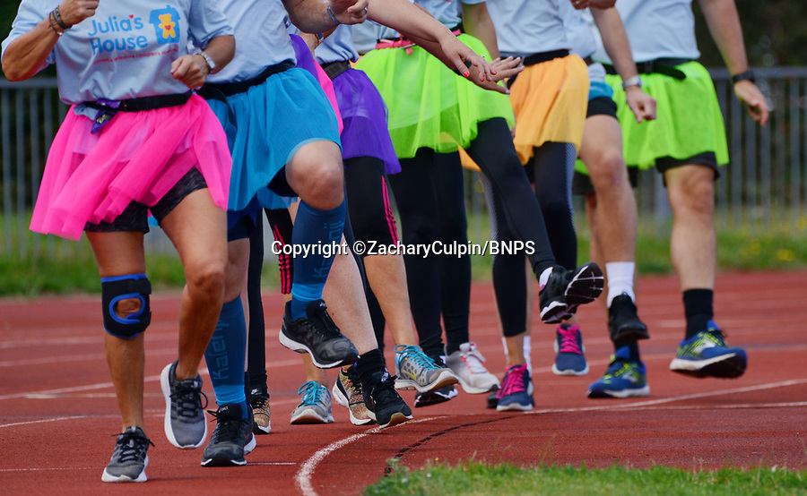 BNPS.co.uk (01202 558833)<br /> Pic: ZacharyCulpin/BNPS<br /> <br /> Weary legs make their way around the track.<br /> <br /> The world record for the longest distance travelled by a conga line has been smashed by a group of co-workers who danced for an incredible 14 miles.<br /> <br /> The team of ten financial advisors spent five-and-a-half hours skipping to the famous Black Lace track in Bournemouth, Dorset.<br /> <br /> They completed an astonishing 57 laps of their local running track - all while the tune 'Do the Conga' played on a loop.