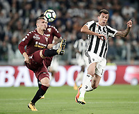 Calcio, Serie A: Torino, Allianz Stadium, 23 settembre 2017. <br /> Torino's Evamgelista Lyanco (l) in action with Juventus' Mario Mandzukic during the Italian Serie A football match between Juventus and Tori0i at Torino's Allianz Stadium, September 23, 2017.<br /> UPDATE IMAGES PRESS/Isabella Bonotto