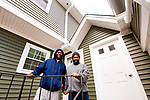 WATERBURY, CT 21_NEW_122017JS01-- Dorrell Bass and his brother Chad Bass, stand outside their new apartment on South Main Street in Waterbury on Wednesday. The family is one of the last ones to find a place to live after being displaced by the Lounsbury Street fire in May that destroyed three homes. <br />