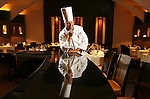 CHEFPROFILE0829rip.jpg.( 08/22/07, Rancho Mirage, Features Food ) Executive Chef Tim Wilcox is reflected in the bar at The Steakhouse restaurant located inside the Agua Caliente Casino in Rancho Mirage on Wednesday, August 22, 2007. (The Press-Enterprise/Rodrigo Pena)