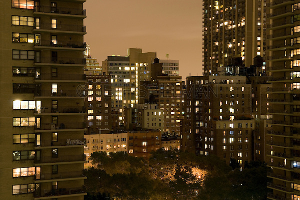 AVAILABLE FROM PLAINPICTURE FOR COMMERCIAL AND EDITORIAL LICENSING.  Please go to www.plainpicture.com and search for image # p5690236.<br /> <br /> Apartment Buildings and Illuminated Windows on an Overcast and Misty Night, Upper West Side of Manhattan, New York City, New York State, USA