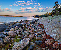 Deer Isle, Maine: Morning light on Jericho Bay with colorful rocks on the shoreline