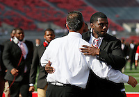 Ohio State Buckeyes head coach Urban Meyer hugs Ohio State Buckeyes quarterback J.T. Barrett (16) as the team walks on to the field before the college football game between the Ohio State Buckeyes and the Cincinnati Bearcats at Ohio Stadium in Columbus, Saturday afternoon, September 27, 2014. (The Columbus Dispatch / Eamon Queeney)
