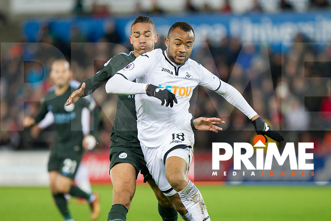 Jordan Ayew of Swansea City pressured by Danilo of Manchester City during the EPL - Premier League match between Swansea City and Manchester City at the Liberty Stadium, Swansea, Wales on 13 December 2017. Photo by Mark  Hawkins / PRiME Media Images.