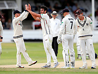 Ollie Robinson high fives Grant Stewart (R) after he bowled Bull during the Specsavers County Championship division two game between Kent and Glamorgan at the St Lawrence Ground, Canterbury, on Sept 18, 2018