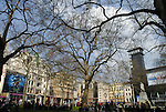 Wide angle view of  buildings and trees in Leicester Square, London, England