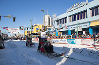 Jeff King and team leave the ceremonial start line with an Iditarider and handler at 4th Avenue and D street in downtown Anchorage, Alaska on Saturday March 4th during the 2017 Iditarod race. Photo © 2017 by Brendan Smith/SchultzPhoto.com.
