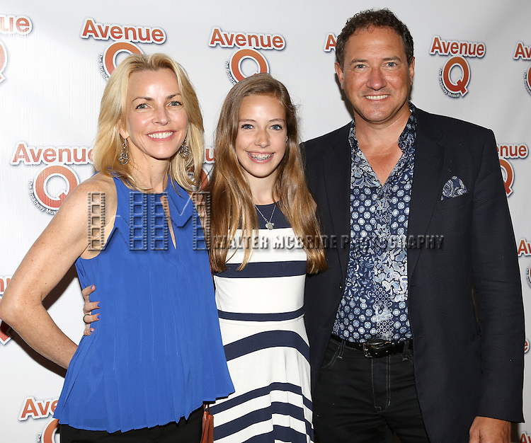 "Lynette Perry-McCollum and Kevin McCollum with daughter  attending the 10th Anniversary Performance of ""Avenue Q"" at The World Stages Theatre on July 31, 2013 in New York City."
