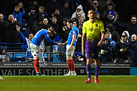 Ronan Curtis of Portsmouth left bows goalscorer John Marquis of Portsmouth during Portsmouth vs Exeter City, Leasing.com Trophy Football at Fratton Park on 18th February 2020