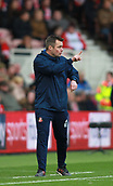 5th November 2017, Riverside Stadium, Middlesbrough, England; EFL Championship football, Middlesbrough versus Sunderland; Robbie Stockdale Coach of Sunderland indicates there is only 1 minute left of the first half