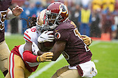 Washington Redskins wide receiver Steven Sims, Jr. (15) is tackled by San Francisco 49ers defensive back Marcell Harris (36) as he returns the opening kick-off during the game at FedEx Field in Landover, Maryland on Sunday, October 20, 2018.  The 49ers won the game 9 - 0.<br /> Credit: Ron Sachs / CNP