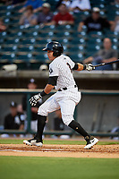 Birmingham Barons second baseman Bryant Flete (3) follows through on a swing during a game against the Pensacola Blue Wahoos on May 8, 2018 at Regions FIeld in Birmingham, Alabama.  Birmingham defeated Pensacola 5-2.  (Mike Janes/Four Seam Images)