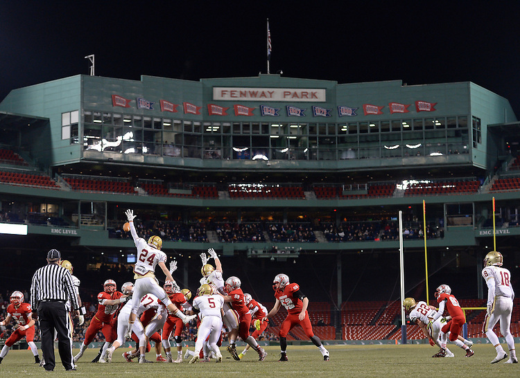 (Boston, MA, 11/25/15) Boston College High School's James Hussey attempts to block a field goal by Catholic Memorial in the first half during a high school football game at Fenway Park in Boston on Wednesday, November 25, 2015. The kick was good. Photo by Christopher Evans