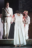 """Pictured: Peter Hoare as Creon, Roland Wood as Oedipus, the King and Julia Sporsen as Antigone, his daughter. Dress rehearsal of Thebans. English National Opera gives world premiere of British composer Julian Anderson's first opera """"Thebans"""" at the London Coliseum. Thebans is based on the three Theban plays by Sophocles that chronicle the cursed life of Oedipus and his daughter Antigone. Thebans opens at the London Coliseum on 3 May 2014 for 7 performances. The new production is supported by The Boltini Trust, PRS for Music Foundation and ENO's Contemporary Opera Group, a co-production with Theater Bonn in Germany. With Roland Wood as Oedipus, Peter Hoare as Creon (Jocasta's brother), Matthew Best as Tiresias (blind prophet), Susan Bickley as Jocasta (Oedipus' mother/wife) and Julia Sporsen as Antigone (Oedipus' daugher). Score by Julian Anderson, libretto by Frank McGuinness, directed by Pierre Audi and conducted by Edward Gardner."""