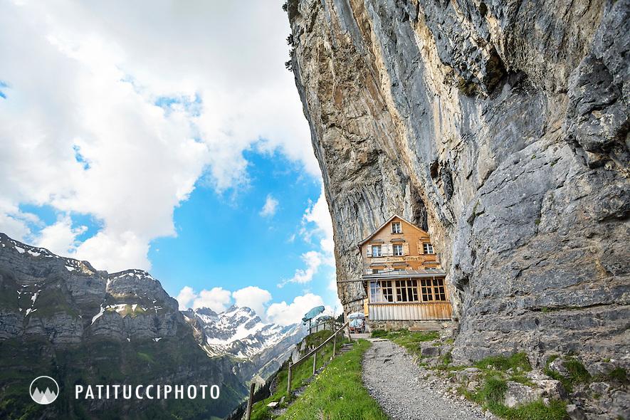 The unique hut and restaurant Berggasthaus Aescher, Wildkirchli, Ebenalp, built into a limestone cliff face, in the Appenzell Region of Switzerland