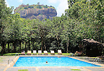 Swimming pool view to Rock Palace at Hotel Sigiriya, Sigiriya, Central Province, Sri Lanka, Asia