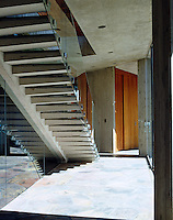 Exterior concrete steps leading from upper to lower floor within the courtyard