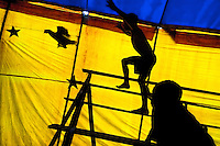 Raimundo, a nine-year old Colombian boy, chases a chicken at the Circo Anny, a family run circus wandering the Amazon region of Ecuador, 4 July 2010. The Circo Anny circus belongs to the old-fashioned traveling circuses with a usual mixture of acrobat, clown and comic acts. Due to the general loss of popularity caused by modern forms of entertainment such as movies, TV shows or internet, these small family enterprises balance on the edge of survival. Circuses were pushed away and now they have to set up their shows in more remote villages. The circus art and culture is slowly dying.
