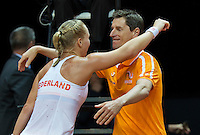 Arena Loire,  Trélazé,  France, 16 April, 2016, Semifinal FedCup, France-Netherlands, Kiki Bertens (NED) als into the arm of captain Paul Haarhuis after she puts the Netherlands in a 2-1 lead<br /> Photo: Henk Koster/Tennisimages