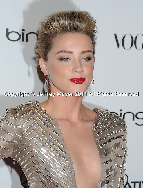 "LOS ANGELES, CA - January 15: Amber Heard arrives at Art Of Elysium's 4th Annual ""Heaven"" Charity Gala at California Science Center's Wallis Annenberg Building on January 15, 2011 in Los Angeles, California."