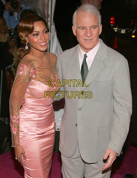 BEYONCE KNOWLES & STEVE MARTIN.The NY premiere of Pink Panther at the Ziegfeld Theatre, New York, NY, USA..February 6th, 2006.Photo: Jackson Lee/AdMedia/Capital Pictures.Ref: JL/ADM.half length grey gray suit jacket pink sheer floral print embroidered dress silk satin.www.capitalpictures.com.sales@capitalpictures.com.© Capital Pictures.