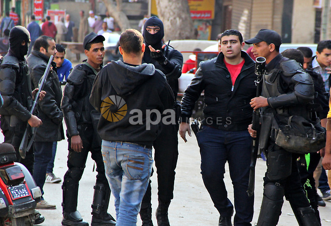 Egyptian police take position for possible protests on al-Haram Street, Cairo, Egypt, 28 November 2014. According to unconfirmed reports at least two Egyptian army officers have been killed and soldiers injured in seperate incidents in Egypt, as some hardline Salafi Muslims heeded calls to hold protests against what they see as the secularisation of Egyptian society and the proliferation of indecent activities, to which Egyptian authorities responded by tightening security measures throughout the country and it has been alleged killing an as yet unconfirmed number of protesters. Photo by Amr Sayed