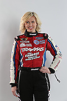 Feb. 22, 2013; Chandler, AZ, USA; NHRA funny car driver Courtney Force poses for some pictures during qualifying for the Arizona Nationals at Firebird International Raceway. Mandatory Credit: Mark J. Rebilas-