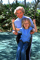 Grandparents and granddaughter on swing girl age