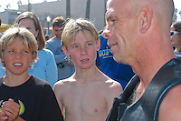 Tom Jones speaks to young admirers (from L) Corten and Spencer at Ocean Beach, Saturday, November 3 2007.  Tom began paddling his 14ft paddle board along the length of the California coastline on August 4th in Crescent City California.  He plans to be the first person to paddle the entire coast and hopes to bring awareness to the problem of plastic pollution in our oceans along the way.  Ocean Beach was the second to last leg of the trip which was due to finish near the Mexican border in Imperial Beach on Sunday, November 4 2007.