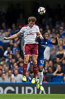 Burnley's James Tarkowski battles for possession with Chelsea's Michy Batshuayi<br /> <br /> Photographer Craig Mercer/CameraSport<br /> <br /> The Premier League - Chelsea v Burnley - Saturday August 12th 2017 - Stamford Bridge - London<br /> <br /> World Copyright &copy; 2017 CameraSport. All rights reserved. 43 Linden Ave. Countesthorpe. Leicester. England. LE8 5PG - Tel: +44 (0) 116 277 4147 - admin@camerasport.com - www.camerasport.com
