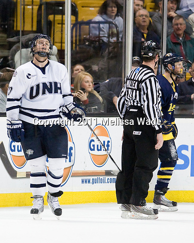 Blake Kessel (UNH - 20), Chris Millea, Elliott Sheen (Merrimack - 11) - The Merrimack College Warriors defeated the University of New Hampshire Wildcats 4-1 in their Hockey East Semi-Final on Friday, March 18, 2011, at TD Garden in Boston, Massachusetts.