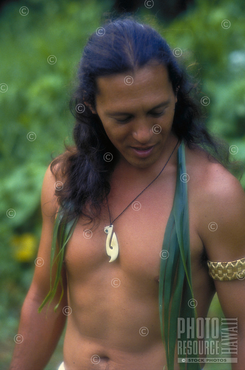 Hawaiian man wearing ti leaf lei with fish hook necklace