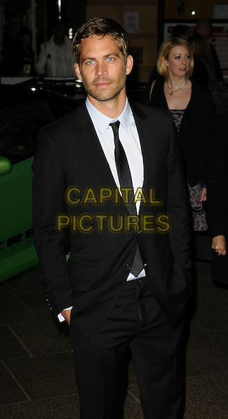 "PAUL WALKER .""Fast & Furious"" UK film premiere at VUE west End cinema, Leicester Square, London, England. .March 19th, 2009 .half 3/4 length black suit hands in pockets stubble facial hair .CAP/CAN.©Can Nguyen/Capital Pictures."