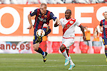Rayo Vallecano´s Kakuta (R) and Barcelona´s Mathieu during La Liga match between Rayo Vallecano and Barcelona at Vallecas stadium in Madrid, Spain. October 04, 2014. (ALTERPHOTOS/Victor Blanco)