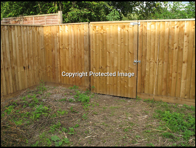BNPS.co.uk (01202 558833)<br /> Pic: Laura Jones/BNPS<br /> <br /> A parish council that blocked a couple's garden gate in a petty row have removed the barricade after a three year battle that has cost the taxpayer £14,000.<br /> <br /> Village hall officials erected a 6ft tall fence across the garden entrance that Michael and Lesley Pearse had used for 19 years to access a public park 15ft away.<br /> <br /> The bureaucrats tried to argue an easement - right of passage - the Pearses had enjoyed was a gift by them which they could withdraw.<br /> <br /> The furious couple insisted the right of way was written into their deeds and asked Queen Thorne Parish Council in Dorset to remove their fence.<br /> <br /> The officials refused, resulting in a legal dispute that lasted for nearly three years until the case was settled in favour of the Pearses on the eve of the matter going to court.