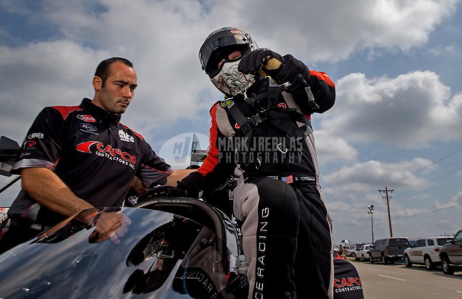 Sept. 1, 2013; Clermont, IN, USA: NHRA top fuel dragster driver Steve Torrence with a crew member during qualifying for the US Nationals at Lucas Oil Raceway. Mandatory Credit: Mark J. Rebilas-