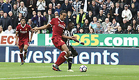 Newcastle United's Christian Atsu is tackled by Liverpool's Joel Matip<br /> <br /> Photographer Rich Linley/CameraSport<br /> <br /> The Premier League -  Newcastle United v Liverpool - Sunday 1st October 2017 - St James' Park - Newcastle<br /> <br /> World Copyright &copy; 2017 CameraSport. All rights reserved. 43 Linden Ave. Countesthorpe. Leicester. England. LE8 5PG - Tel: +44 (0) 116 277 4147 - admin@camerasport.com - www.camerasport.com