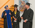 "Western Nevada College Instructor Dr. Doris Dwyer, left, gives the ""thumbs up"" to graduating students Sylvia Doioron and Dave Hardin before the Fallon commencement ceremony, in Fallon, Nev., on Tuesday, May 20, 2014. <br /> Photo by Kim Lamb/Nevada Photo Source"