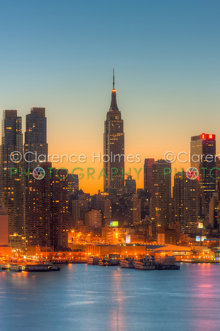 The Empire State Building during morning twilight as viewed over the Hudson River looking east from New Jersey.  The eastern sky was accented with tinges of orange that began to show in the hour before sunrise.