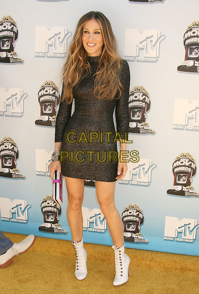 SARAH JESSICA PARKER.Arrivals - 2008 MTV Movie Awards held at Gibson Amphitheatre, Universal City, California, USA, 01 June 2008..full length black sparkly long sleeved tight dress white ankle boots lace-up clutch bag .CAP/ADM/MJ.©Michael Jade/Admedia/Capital Pictures