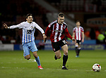 Ruben Lameiras of Coventry City in action with Paul Coutts of Sheffield United during the English League One match at the Bramall Lane Stadium, Sheffield. Picture date: April 5th, 2017. Pic credit should read: Jamie Tyerman/Sportimage