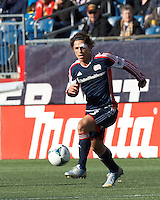 New England Revolution midfielder Ryan Guy (13) brings the ball forward. .  In a Major League Soccer (MLS) match, FC Dallas (red) defeated the New England Revolution (blue), 1-0, at Gillette Stadium on March 30, 2013.
