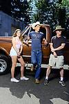 "Twins Leslie and Alex Strandgard, 16, of Lynden, stand in front of Alex's truck with their father, Rich, across the street from a campaign stop and rally by Republican Presidential Candidate Donald Trump in Lynden, Washington at the Northwest Washington Fairgrounds Saturday May 7, 2016. ""Lynden is a real conservative town,"" Rich said. ""We weren't sure if there was going to be any trouble. You hear only snippets of his speech. I kind of wanted to see what else he talks about."" Photo by Daniel Berman/www.bermanphotos.com"