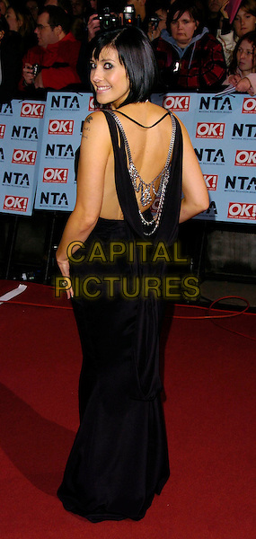 KYM RYDER.The National Television Awards 2006 held at the Royal Albert Hall, London, UK. - Arrivals.October 31st, 2006.Ref: CAN.full length dress black Kim Rider looking over shoulder chains.www.capitalpictures.com.sales@capitalpictures.com.©Can Nguyen/Capital Pictures