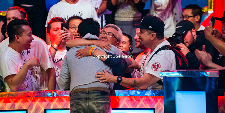 John Cynn gets a hug from dad