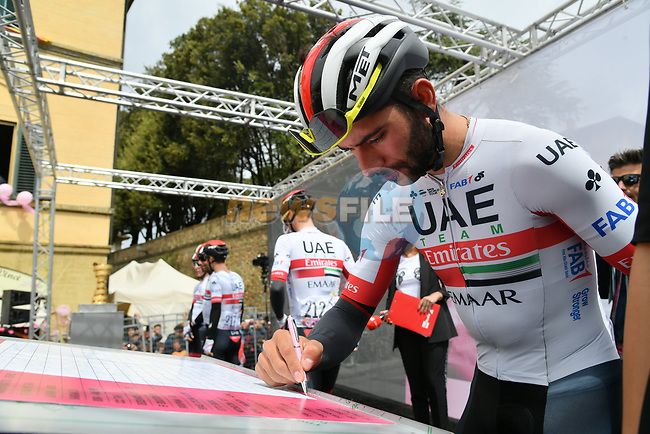 Fernando Gaviria (COL) UAE Team Emirates signs on before Stage 3 of the 2019 Giro d'Italia, running 220km from Vinci to Orbetello, Italy. 13th May 2019<br /> Picture: Gian Mattia D'Alberto/LaPresse | Cyclefile<br /> <br /> All photos usage must carry mandatory copyright credit (© Cyclefile | Gian Mattia D'Alberto/LaPresse)
