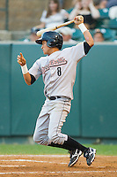 Hector Rodriguez #8 of the Greeneville Astros follows through on his swing against the Pulaski Mariners at Calfee Park August 29, 2010, in Pulaski, Virginia.  Photo by Brian Westerholt / Four Seam Images